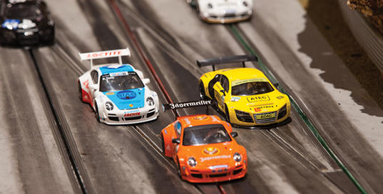 Slot-cars-race-like-real-cars-using-Nordic-2.4GHz-transceivers-to-support-up-to-24-over-taking-cars-on-any-number-of-lanes-ghost-cars-and-over-the-air-updates_full_article